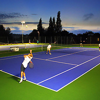 Sport, Tennis, Dusk, flood lit, The Pines, Holiday Village, Gurnard, Isle of Wight, UK, photography photograph canvas canvases