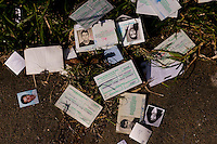 Scattered photo id's of  litter the ground as maquila workers scavenge  what they can after the unexpected closing of clothing factory in San Lucas Wednesday Nov. 7, 2007 Guatemala. A common occurrence in Centeral America, the South Korean owners fled the country with out paying the employees their due wages and severance  packages.  ..........