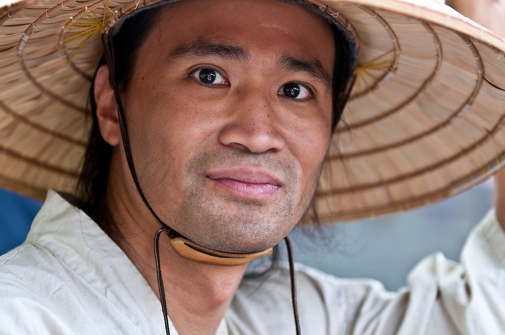 Portrait of young oriental male with typical hat.