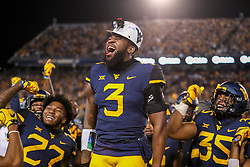 Oct 25, 2018; Morgantown, WV, USA; West Virginia Mountaineers safety Toyous Avery Jr. (3) celebrates after intercepting a pass during the first quarter against the Baylor Bears at Mountaineer Field at Milan Puskar Stadium. Mandatory Credit: Ben Queen-USA TODAY Sports