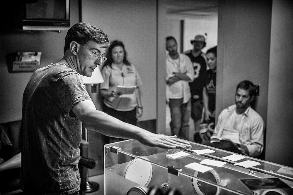 Director Eric Heisserer discussing a scene on the set of HOURS with actor Paul Walker.