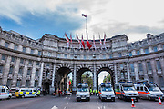 Police vans guard Admirallty arch in case a couple of protest marches spill over into the people arriving for the evening concert. VE Day 70 commemorations - Three days of events in London and across the UK marking historic anniversary of end of the Second World War in Europe. Trafalgar Square, scene of jubilant celebrations marking the end of the Second World War in Europe on 8 May 1945, plays a central part in a host of national events, which include a Service of Remembrance at the Cenotaph, a concert in Horse Guards Parade, a Service of Thanksgiving at Westminster Abbey, a parade of Service personnel and veterans and a flypast.
