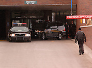 Vehicles from the Macom County Sheriff Department transporting murder suspect Stephen Grant (in right vehilcle) pull away from Northern Michigan Hospital in Petoskey.