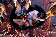 Students from sororities and fraternities at Kansas State University get dunked into a tub of watermelons during the Watermelon Bust event on September 1, 2011 in Manhattan, Kansas.