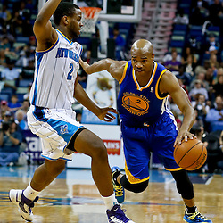 Mar 18, 2013; New Orleans, LA, USA; Golden State Warriors point guard Jarrett Jack (2) drives past New Orleans Hornets small forward Darius Miller (2) during the second half of a game at the New Orleans Arena. The Warriors defeated the Hornets 93-72.  Mandatory Credit: Derick E. Hingle-USA TODAY Sports