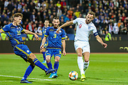 England forward Harry Kane challenged by Kosovo defender Mergim Vojvoda  during the UEFA European 2020 Qualifier match between Kosovo and England at the Fadil Vokrri Stadium, Pristina, Kosovo on 17 November 2019.