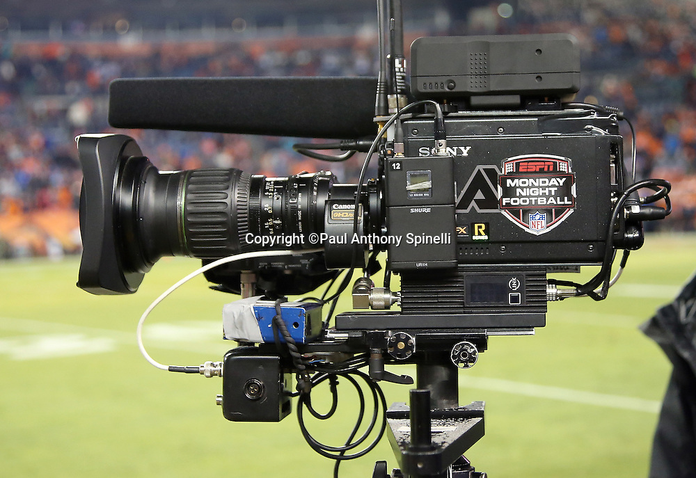 A sideline television camera stands ready for the Denver Broncos 2015 NFL week 16 regular season football game against the Cincinnati Bengals on Monday, Dec. 28, 2015 in Denver. The Broncos won the game in overtime 20-17. (©Paul Anthony Spinelli)
