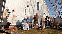 """The Gilford Community Church presented the Living Nativity scene Sunday afternoon outside the Thompson Ames Historical Society.  The Angel (Donna Fowler), Mary (Kathy Lacroix), Joseph (Jim Colby), Innkeeper (Peter Ayer),  oxen """"Chip"""" and the Three Wise Men (George Hetherington, Leon Albushies and Carl Gebhardt).   (Karen Bobotas/for the Laconia Daily Sun)"""