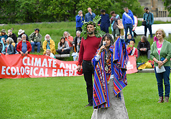 Climate change protesters marched down the Royal Mile from Edinburgh Castle to the climate change camp at the Scottish Parliament.<br /> <br /> © Dave Johnston / EEm