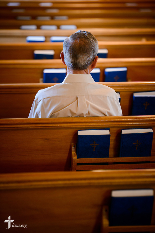 A church member listens as the Rev. Steven Struecker, full-time farmer and pastor of Immanuel Lutheran Church, Livermore, Iowa, and Zion Evangelical Lutheran Church, Lu Verne, Iowa, preaches at the church in Livermore on Sunday, July 9, 2017. LCMS Communications/Erik M. Lunsford