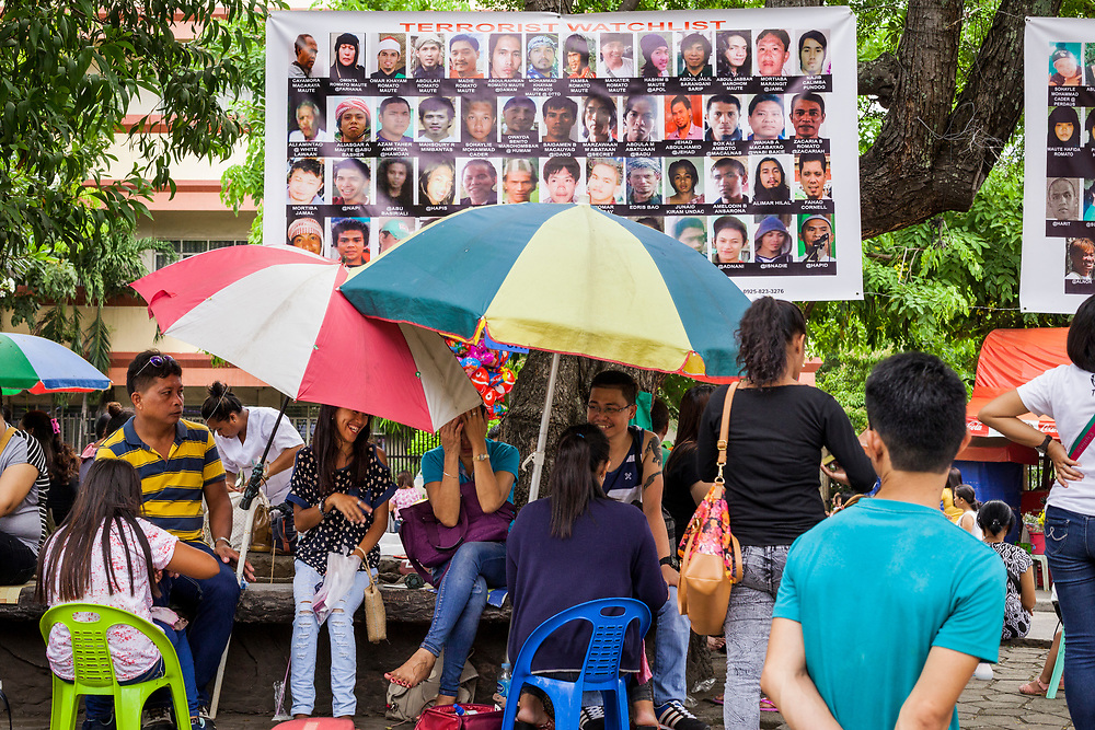 Davao City, Mindanao, Philippines - JUNE 18: A large poster of Wanted Terrorist are seen posted across from San Pedro Cathedral.  On December 28, 1993,  San Pedro Cathedral was bombed during a Sunday evening mass killing seven and wounding 151.