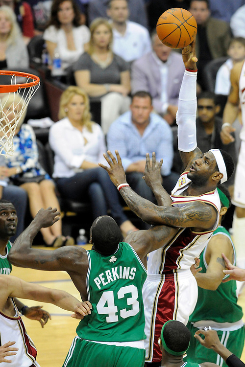 May 1, 2010; Cleveland, OH, USA; Cleveland Cavaliers forward LeBron James (23) shoots over Boston Celtics center Kendrick Perkins (43) during the first quarter of game one in the eastern conference semifinals in the 2010 NBA playoffs at Quicken Loans Arena. Mandatory Credit: Dave Miller-US PRESSWIRE