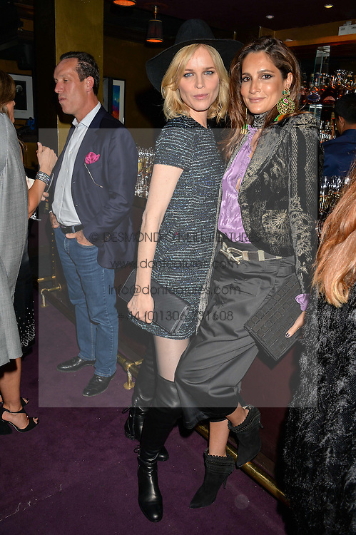 Left to right, EVA HERZIGOVA and ASTRID NOVILLO ASTRADA at Hoping's Greatest Hits - the 10th Anniversary of The Hoping Foundation's charity benefit held at Ronnie Scott's, 47 Frith Street, Soho, London on 16th June 2016.