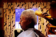 &quot;I'm going to do this till I can't stand up,&quot; said Odell Jackon as he finished cutting Bill Dixon's hair at Jackson's barber shop on Bluff Road. Dixon, 76, has been getting his haircut from Jackson since 1973. &quot;I don't know what makes him a good barber but I've always been satisfied.&quot; <br />  &quot;Just  being here is unique,&quot; said owner Odell Jackson, 58. &quot;You should see all the different people that you meet.&quot;<br /> The old building used to be a seamstress shop and a Magistrate's office. &quot;Then I dropped in.&quot;