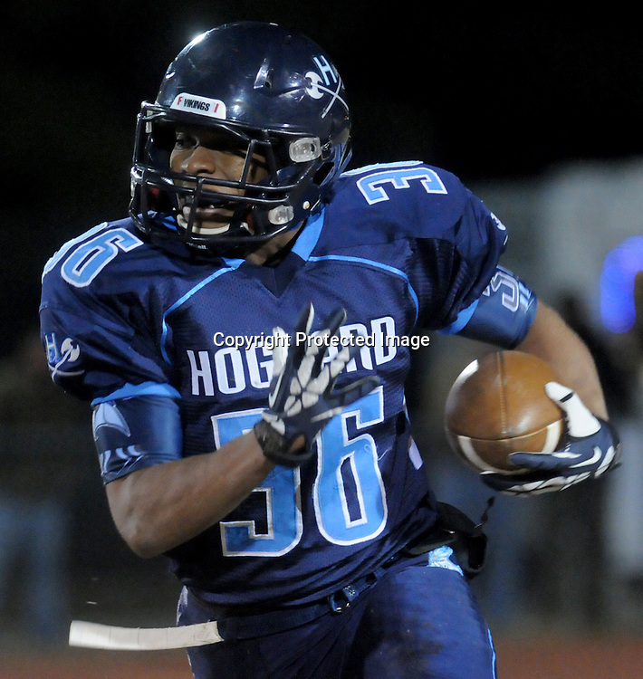 Keevin Thompson rushes against Cape Fear Friday November 21, 2014 at Hoggard High School in Wilmington, N.C. (Jason A. Frizzelle)
