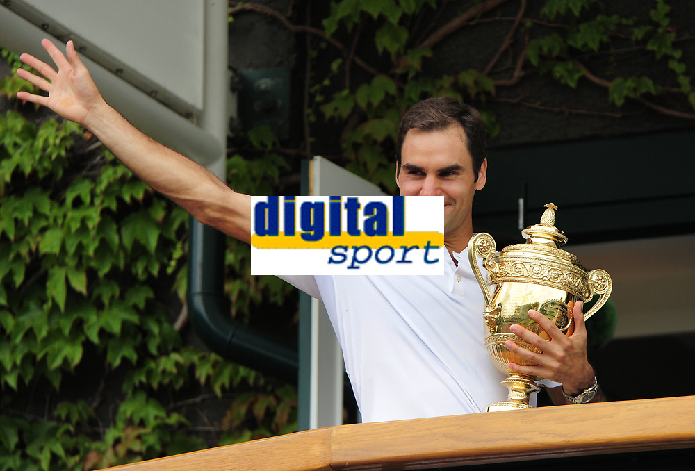 Tennis - 2017 Wimbledon Championships - Week Two, Sunday [Day Thirteen]<br /> 	<br /> Men Doubles Final match	<br /> <br /> Marin Cilic (CRO) vs Rodger Federer (SUI)<br /> 	<br /> Rodger Federer shows off the trophy to the fans outside Centre court , from the Balcony <br /> 	<br /> COLORSPORT/ANDREW COWIE