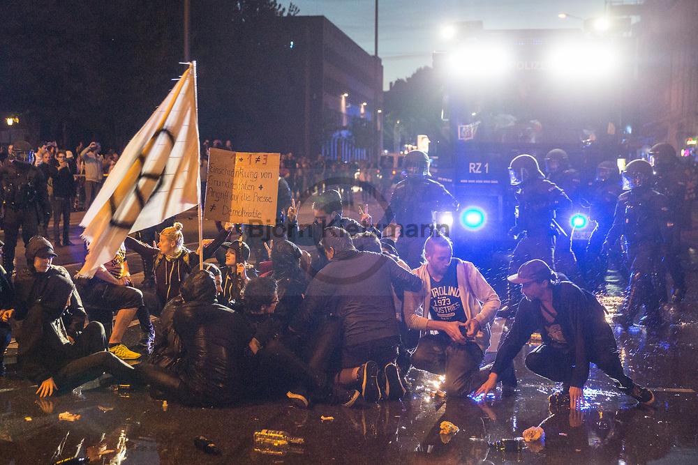 Hamburg, Germany - 08.07.2017<br /> <br /> Police forces clear with a water cannon a no G20 sit in at Pferdemarkt in Hamburg.<br /> <br /> Polizeikraefte raeumen unter anderem mit einem Wasserwerfer eine Sitzblockade am Pferdemarkt. Anti G20 Proteste in Hamburg.<br /> <br /> Photo: Bjoern Kietzmann