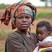A woman holds her infant son near the dried up water source of Burega Pond, Rulindo District, Rwanda.