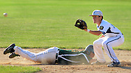 LANGHORNE, PA - JUNE 27:  Newtown's Chase D'Arcangelo slides back to second base as Yardley Western's shortstop Ben Decembrino awaits the ball during the Newtown vs. Yardley Western Legion baseball game at Cairn University June 27, 2014 in Langhorne, Pennsylvania.  (Photo by William Thomas Cain/Cain Images)