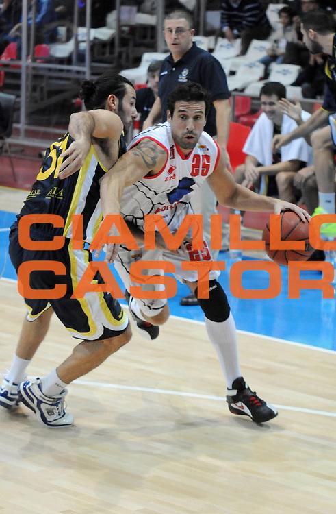DESCRIZIONE : Piacenza Campionato Lega Basket A2 2011-12 Morpho Basket Piacenza Givova Scafati<br /> GIOCATORE : German Scarone<br /> SQUADRA : Morpho Basket Piacenza<br /> EVENTO : Campionato Lega Basket A2 2011-2012<br /> GARA : Morpho Basket Piacenza Givova Scafati<br /> DATA : 30/10/2011<br /> CATEGORIA : Palleggio Penetrazione<br /> SPORT : Pallacanestro <br /> AUTORE : Agenzia Ciamillo-Castoria/L.Lussoso<br /> Galleria : Lega Basket A2 2011-2012 <br /> Fotonotizia : Piacenza Campionato Lega Basket A2 2011-12 Morpho Basket Piacenza Givova Scafati<br /> Predefinita :