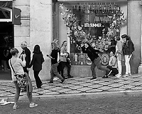 Photo Bomb. Morning Street Photography in Lisbon. Image taken with a Leica CL camera and 23 mm f/2 lens.