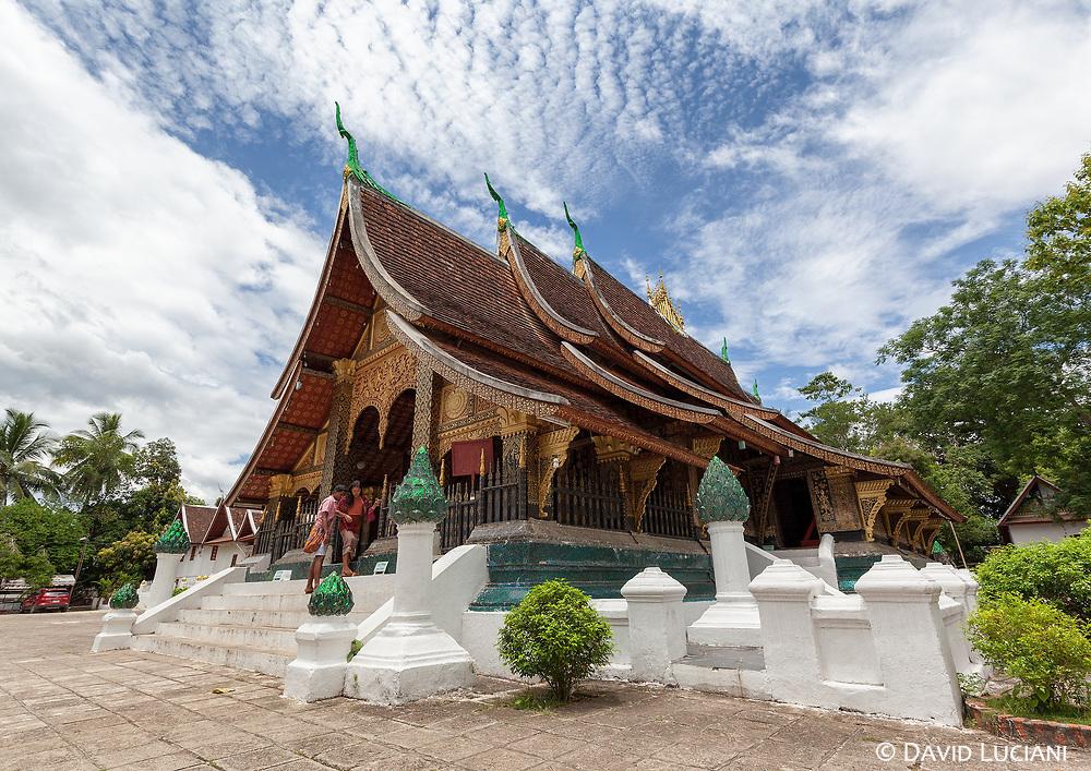 A couple leaving Wat Xieng Thong temple in Luang Prabang.
