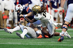 Auburn Tigers quarterback Jarrett Stidham (8) is tackled by UCF Knights linebacker Shaquem Griffin (18) during the 2018 Chick-fil-A Peach Bowl NCAA football game against the on Monday, January 1, 2018 in Atlanta. (Paul Abell / Abell Images for the Chick-fil-A Peach Bowl)