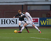 3rd February 2018, Dens Park, Dundee, Scotland; Scottish Premier League football, Dundee versus Ross County; Simon Murray of Dundee takes on Jason Naismith of Ross County