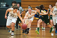 St. Johnsbury's Kayla Matte (2) battles for the loose ball with Essex's Mychaela Harton (32) and Olivia Duncan (40) during the girls basketball game between the St. Johnsbury Hilltoppers and the Essex Hornets at Essex high school on Tuesday night January 5, 2016 in Essex. (BRIAN JENKINS/for the FREE PRESS)