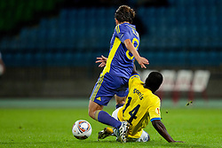 Dejan Mezga of NK Maribor and Morgaro Gomis of Birmingham City at 2nd Round of Europe League football match between NK Maribor (Slovenia) and Birmingham City (England), on September 29, 2011, in Maribor, Slovenia.  (Photo by Urban Urbanc / Sportida)