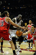 Apr 27, 2010; Cleveland, OH, USA; Cleveland Cavaliers center Shaquille O'Neal (33) is defended by Chicago Bulls center Joakim Noah (13) and Chicago Bulls guard Kirk Hinrich (12) during the first period in game five in the first round of the 2010 NBA playoffs at Quicken Loans Arena.  Mandatory Credit: Jason Miller-US PRESSWIRE