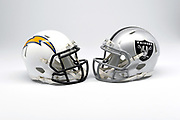 Detailed view of Los Angeles Chargers and Oakland Raiders helmets.