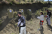 Bill Dragoo (left), Val (center) and Gary Kepple (right) throwing knives during pit competition at 2010 Rawhyde Adventure Rider Challenge