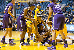 Players from West Virginia and TCU dive for a ball in the lane at the WVU Coliseum.