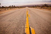 Stretch of empty road through the Mojave Desert in the Mojave National Preserve, San Bernardino, CA