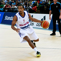 GB men vs Puerto Rico basketball at the Copper Box Arena. Justin Robinson (07) drives to the basket. 11/08/2013 (c) MATT BRISTOW