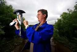 CANADA ALBERTA FORT MCMURRAY 19JUL09 - Greenpeace campaigner Christoph von Lieven uses an analysis tool to measure water quality at the Athabasca River north of Fort McMurray, northern Alberta, Canada...jre/Photo by Jiri Rezac / GREENPEACE..© Jiri Rezac 2009