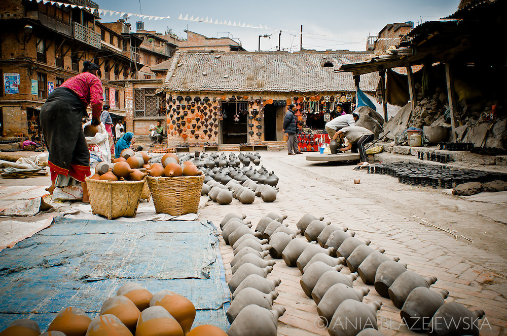 Nepal, Bhaktapur. People working on Pottery Square - one of the most popular tourist sites in Kathmandu Valley.