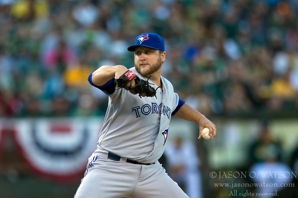 OAKLAND, CA - JULY 05:  Mark Buehrle #56 of the Toronto Blue Jays pitches against the Oakland Athletics during the first inning at O.co Coliseum on July 5, 2014 in Oakland, California. The Oakland Athletics defeated the Toronto Blue Jays 5-1.  (Photo by Jason O. Watson/Getty Images) *** Local Caption *** Mark Buehrle