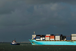 March 2, 2016 - Container ship entering Rotterdam harbour with help of tug boat (Credit Image: © Cultura via ZUMA Press)