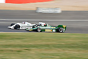 Car 46 passes car 80 around the outside of abbey. Silverstone Classic - 66-85 F1- 25/7/10.