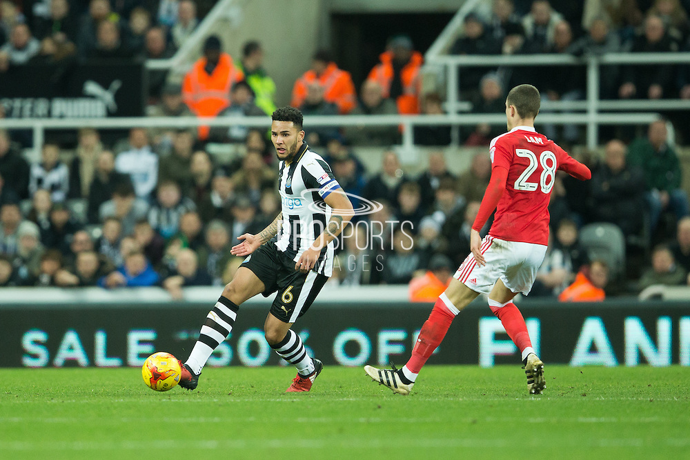 Newcastle United defender Jamaal Lascelles (#6) passes the ball away from Nottingham Forest defender Thomas Lam (#28) during the EFL Sky Bet Championship match between Newcastle United and Nottingham Forest at St. James's Park, Newcastle, England on 30 December 2016. Photo by Craig Doyle.