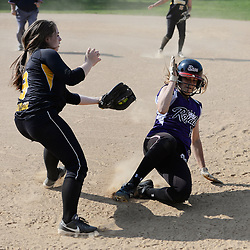 Staff photos by Tom Kelly IV<br /> Upper Darby's Carli Benozich (9) slides safely back into first base under the tag of Interboro's Miranda Baylor (9) after being caught in a rundown during the Interboro at Upper Darby girls softball game, Friday afternoon.