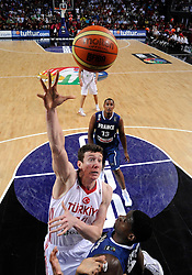 Omer Asik of Turkey vs Ian Mahinmi of France during  the eight-final basketball match between National teams of Turkey and France at 2010 FIBA World Championships on September 5, 2010 at the Sinan Erdem Dome in Istanbul, Turkey. (Photo By Vid Ponikvar / Sportida.com)