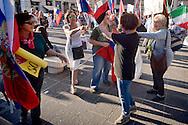 """Roma 3 Ottobre 2015<br /> Manifestazione a sostegno del Presidente russo Putin, a  Piazzale Flaminio,  """"Io sto con Putin"""" , per sconfiggere il terrorismo islamico, per fermare la crisi migratoria, per ritrovare la sovranità"""". I manifestanti chiedono anche l'immediata rimozione delle sanzioni alla Russia. La manifestazione è organizzata dal Comitato Italia-Russia e dal Vladimir Putin Italian Fan Club. Manifestanti pro Putin allontanano una donna ucraina (maglia nera) con la bandiera rossa e nera che era stata utilizzata dai collaborazionisti ucraini con la  Germania nazista. <br /> Rome, October 3, 2015<br /> Rally in support of Russian President Putin, Piazzale Flaminio, """"I'm with Putin"""", to defeat Islamic terrorism, to stop the migration crisis, to regain sovereignty.The protesters are also demanding the immediate removal of sanctions on Russia.The event is organized by the committee Italy-Russia,  and  from Vladimir Putin the Italian Fan Club. Demonstrators pro Putin hunt a Ukrainian woman with (black shirt) red and black flag, that was used by Ukrainian collaborators with Nazi Germany."""