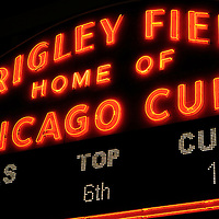 Wrigley Field sign at night. Wrigley Field is home of the Chicago Cubs. High resolution prints and stock photos are available.