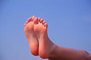 AYBT2C Two feet together against blue sky