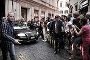 Uomini della sicurezza liberano la strada da curiosi e giornalisti durante l'uscita in auto di Silvio Berlusconi dopo l'inaugurazione della nuova sede del partito Forza Italia. Roma, 19 settembre 2013. Christian Mantuano / OneShot <br /> <br /> Security men free the road from onlookers and journalists during the exit by car of Silvio Berlusconi after the inauguration of the new headquarters of the party Forza Italia. Rome, 19 September 2013. Christian Mantuano / OneShot