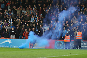 Coventry fans off a flare during the EFL Sky Bet League 2 match between Cheltenham Town and Coventry City at LCI Rail Stadium, Cheltenham, England on 28 April 2018. Picture by Antony Thompson.