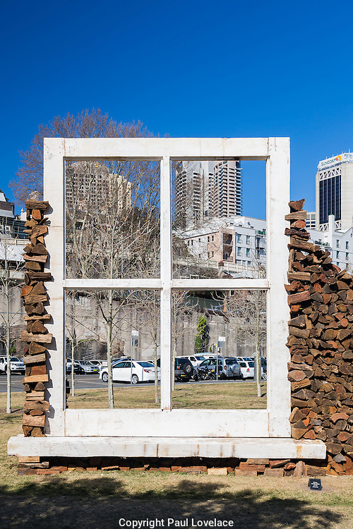 Sculpture at Barangaroo showing artwork titled Empirical View, 2016, a four metre high derelict window by artist Marcus Tatton. This monument represents Tatton's acknowledgement of the sites history.The art show falls at the same time  as Barangaroo Reserve celebrates its first birthday.